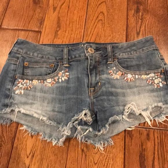 American Eagle Outfitters Pants - Medium wash. American Eagle cutoff jean shorts